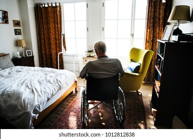 Senior man sitting on the wheelchair alone