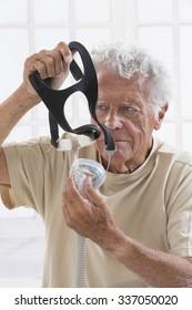 Senior Man with sleeping apnea machine
