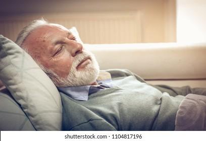 Senior man sleeping in bed. Close up.