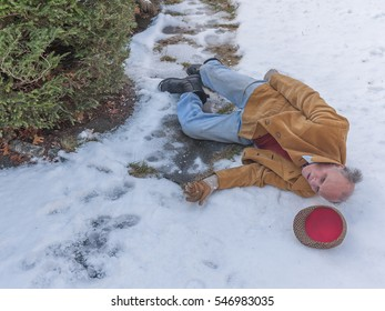 Senior man slipping on ice on his walkway