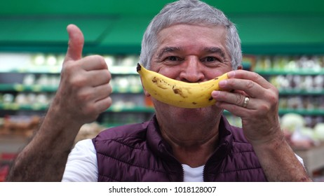 Senior Man Smiling With Banana