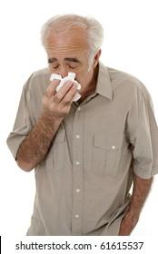 Senior man sneezing isolated on white