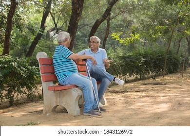 Senior man spending free time at park