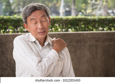 senior man suffering from elbow joint pain or injury or stiffness, old man with osteoporosis, arthritis, injury, inflammation, gout, rheumatoid symptoms