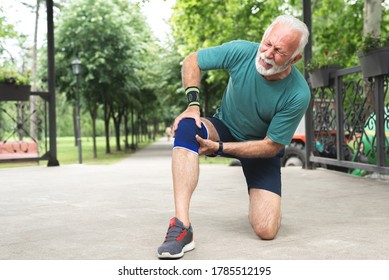 Senior man suffering with knee pain during workout