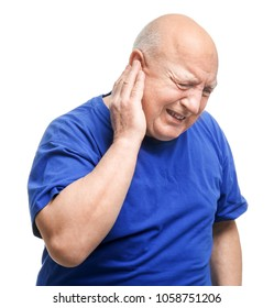 Senior man suffering from pain in ear on white background