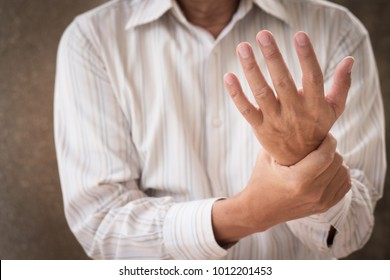 senior man suffering from wrist carpal tunnel syndrome cps or injury, old man with osteoporosis, arthritis, injury, inflammation, gout, rheumatoid symptoms
