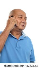Senior man talking to cellphone. Isolated on white background.