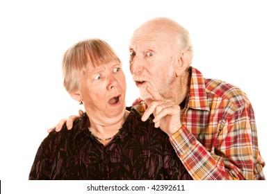 Senior man talking to his shocked wife