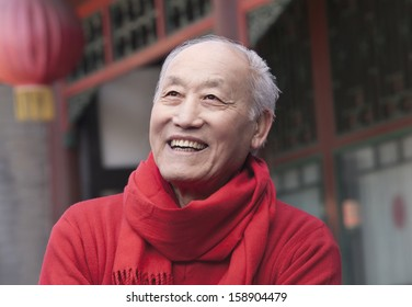 Senior man in traditional Chinese courtyard