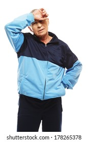 Senior man in training suit feeling headache migraines