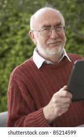 Senior man using a Tablet PC