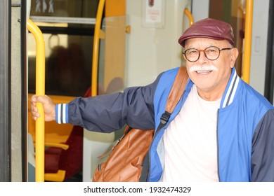 Senior man using a train