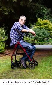 Senior Man using a walker outdoors