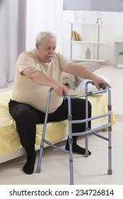 Senior Man Using Walking Frame