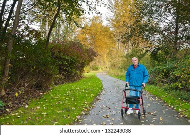 Senior Man with Walker on Hiking Trail in Park