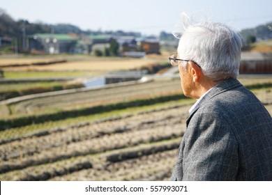 Senior man walking outside