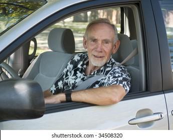 Senior man at wheel of car. Focus on face.