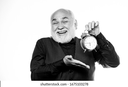 Senior man white beard. Senior timekeeper. Counting time. Time does not spare anyone. Time and age concept. Bearded man clock ticking. Aged man holding alarm clock. Lifetime ageing and getting older.