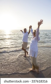 Senior man and woman couple walking together at sunset or sunrise on a beautiful tropical beach