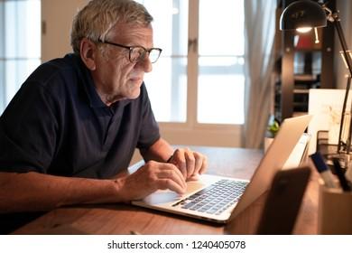 Senior man working on a laptop
