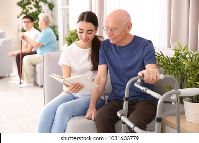 Senior man with young caregiver at home