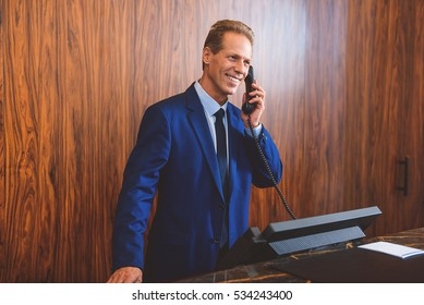 Senior manager answering call in lobby