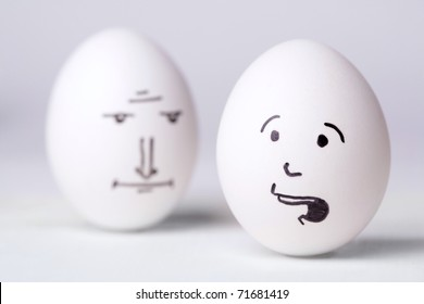 Senior manager egg looking at  unhappy manager egg