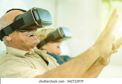 e5db20c591 Senior mature couple having fun with virtual reality glasses - Old people  using new headset goggles