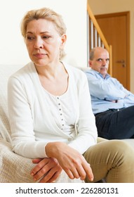 Senior mature couple having quarrel at living room