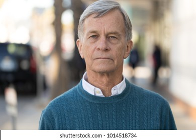 Senior mature man serious face portrait