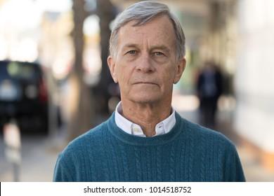 Senior mature man serious face portrait