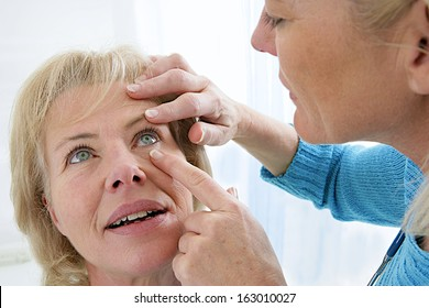 Senior medical check up with focus on eyes examination