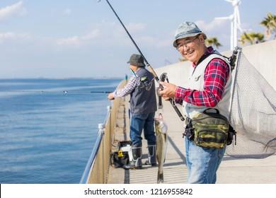 Senior men enjoying lure fishing