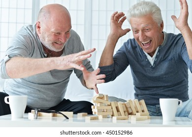 senior men playing  board game