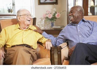 Senior men relaxing in armchairs