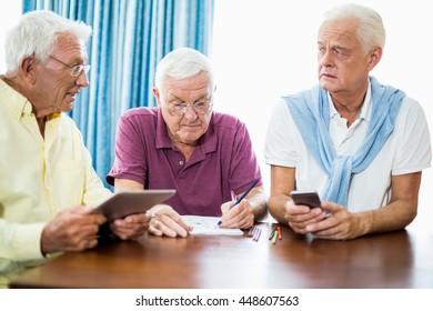 Senior men spending time together in a retirement home