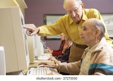 Senior men using computer