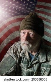 Senior military man in front of American flag with a rough background