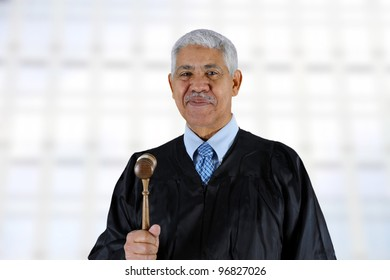 Senior minority judge in his gown at work