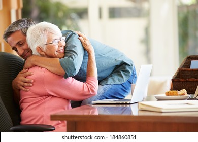 Senior Mother Being Comforted By Adult Son