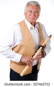 senior musician with native american flute and leather vest