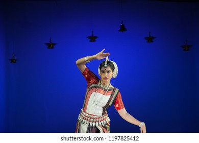 A senior Odissi dancer looks at the peacock at the Divyashetram event on October 3,2018 in Bengaluru,India