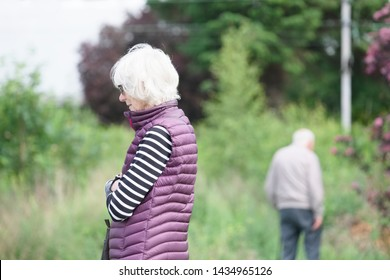 Senior old couple together with dementia brain disease feel sad and loss of love