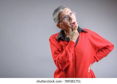 Senior old lady having troubles remembering something