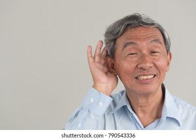senior old man listening to good news