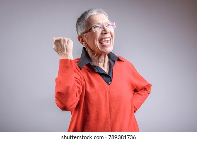 Senior old woman cheering and feeling sense of achievement