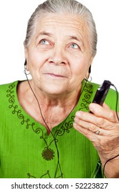 Senior old woman listening music at mobile phone