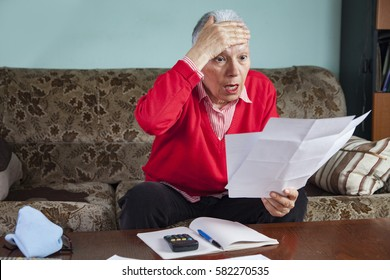 Senior old woman shocked with the bills she receives, appalled and angry