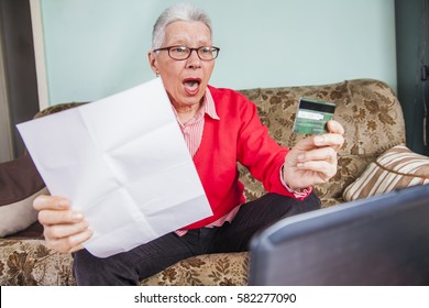 Senior old woman shocked by her credit card bill